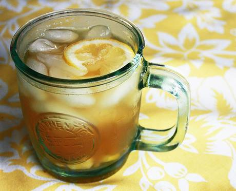 Cup of iced lemon and ginger tea