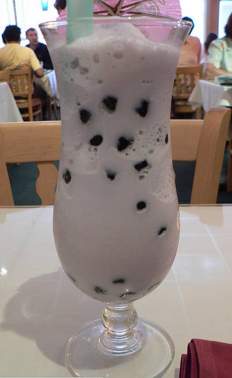 A glass of iced Taro bubble tea